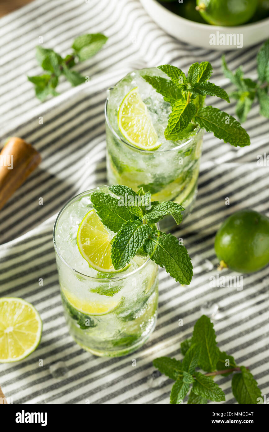 Refreshing Mint and LIme Mojitos with Rum and Soda Water - Stock Image