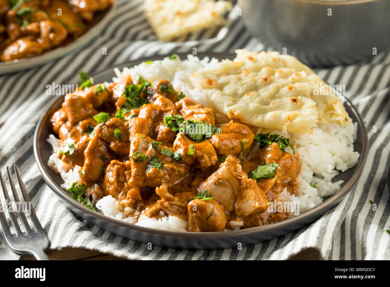 Homemade Indian Butter Chicken With Rice And Naan Bread Stock Photo Alamy