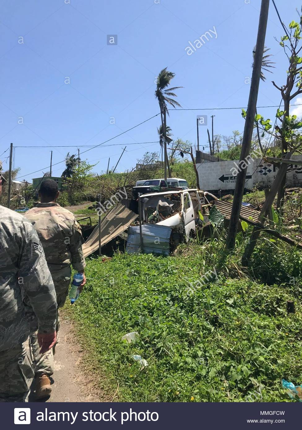U.S. service members survey damage, Oct. 9, 2017 on the Caribbean island of Dominica. The island was devastated by Hurricane Maria, a Category 5 storm that made landfall Sept. 19, 2017, spurring support from the Joint Base Lewis-McChord community, as well as military installations across the globe. (Courtesy Photo) - Stock Image
