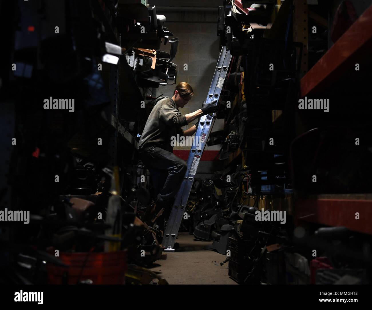 Mr  Kyle Short, a mechanic at FN Jeep, climbs down a ladder after