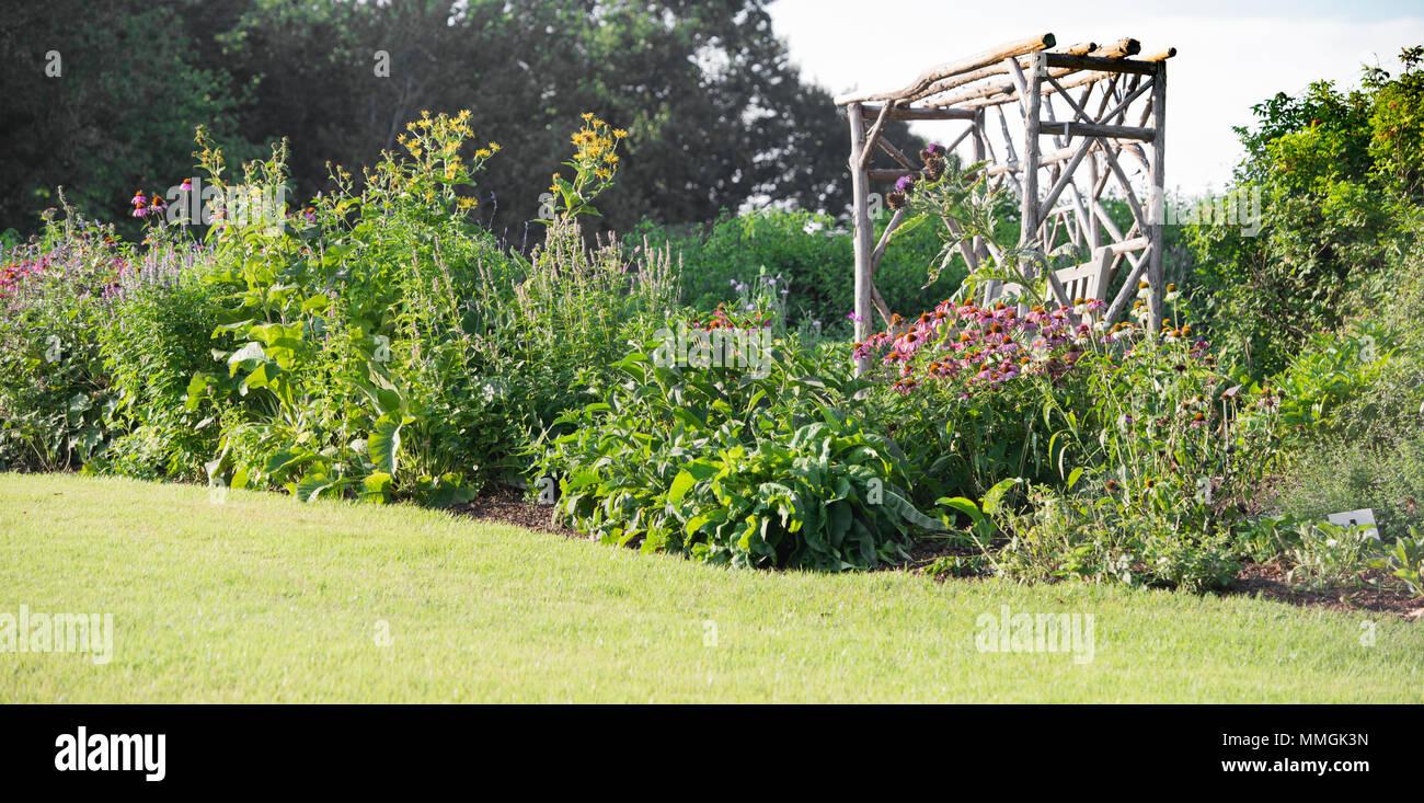 Green and flowered Garden Landscape and garden arbor seating. Meadowlark, Gardens, Vienna, Virginia - Stock Image