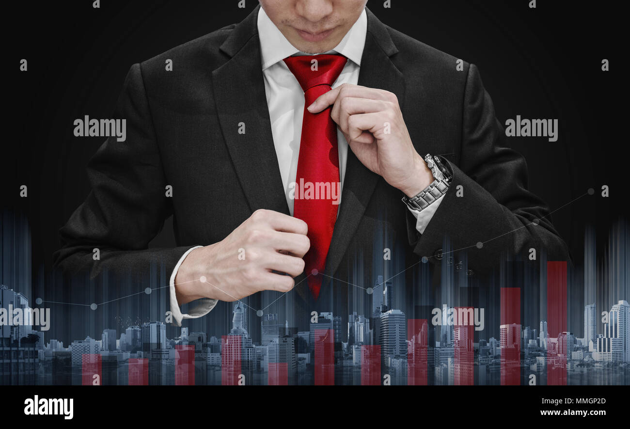 Businessman tying red necktie and raising graph diagram with building technology. Business growth and investment Stock Photo