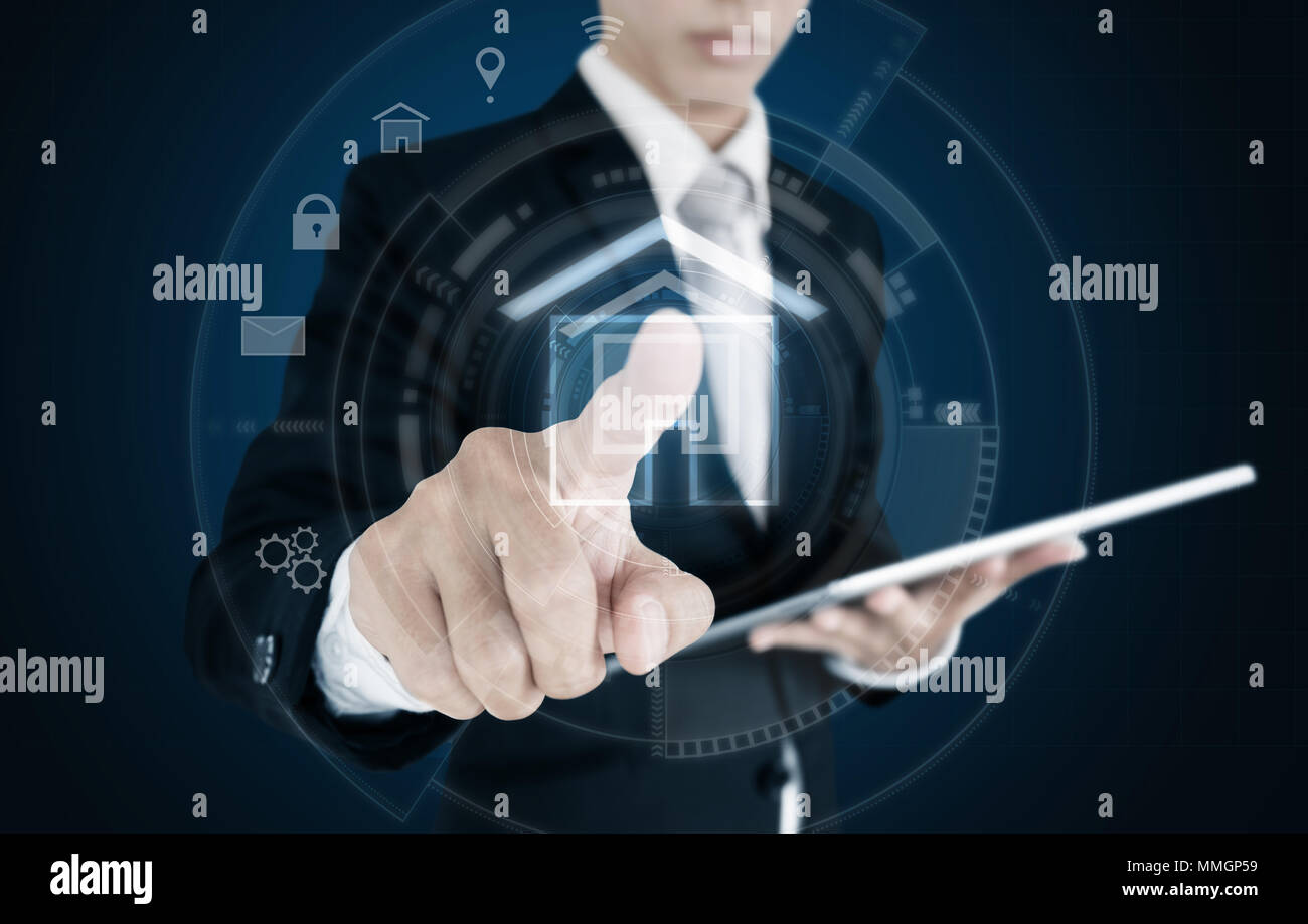 Businessman pressing on virtual home icon. Smart home, buildings and real estate business concept Stock Photo