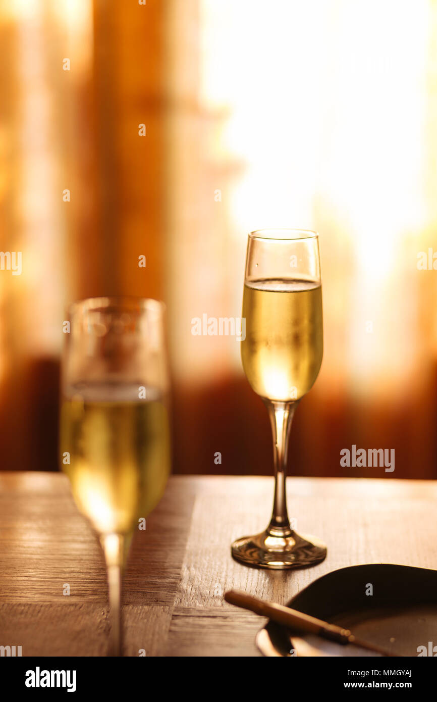 Flutes filled with sparkling prosecco, in a restaurant in Conegliano. Prosecco is a white sparkling wine cultivated and produced in Valdobbiadene - Stock Image