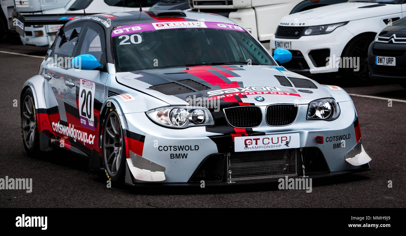 A Highly Modified Bmw 1 Series Gt3 Racing Car Driving Through The