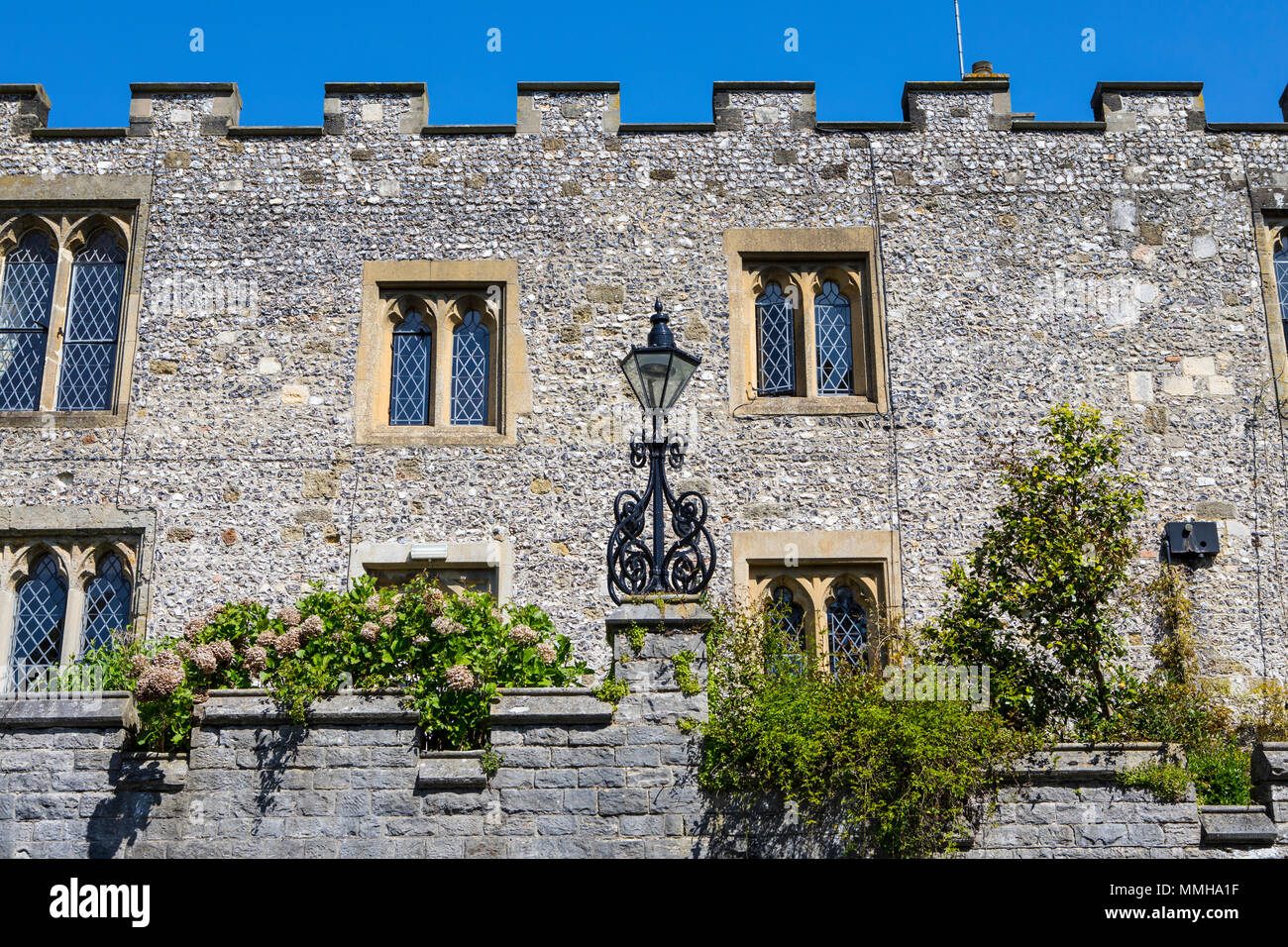 A view of the medieval exterior of St. Wilfrids Priory in the market town of Arundel in West Sussex, UK. - Stock Image