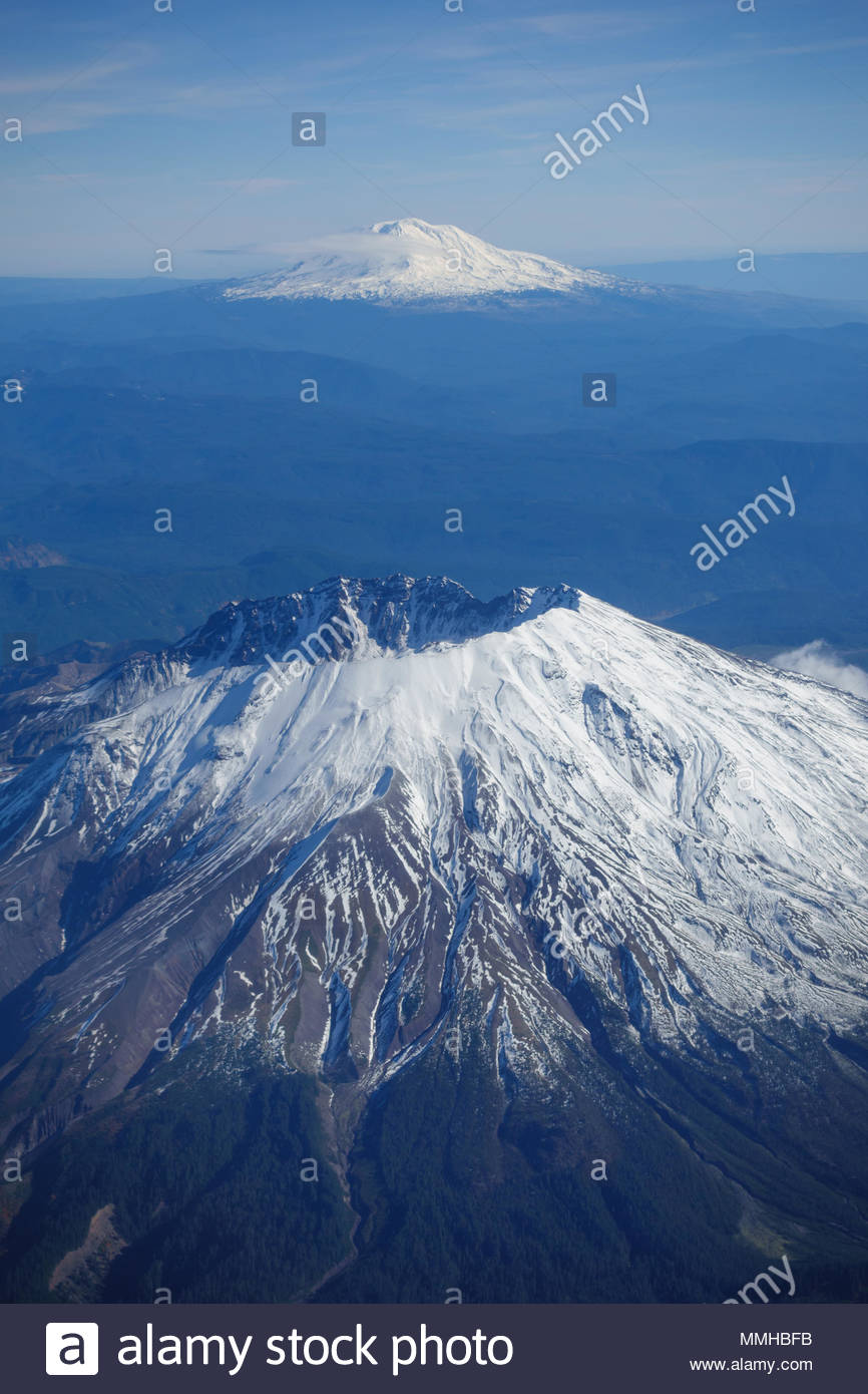 Snowcapped Mount Saint Helens is seen in front of Mount Rainier in an aerial image taken from a commercial airliner flying over Washington State - Stock Image