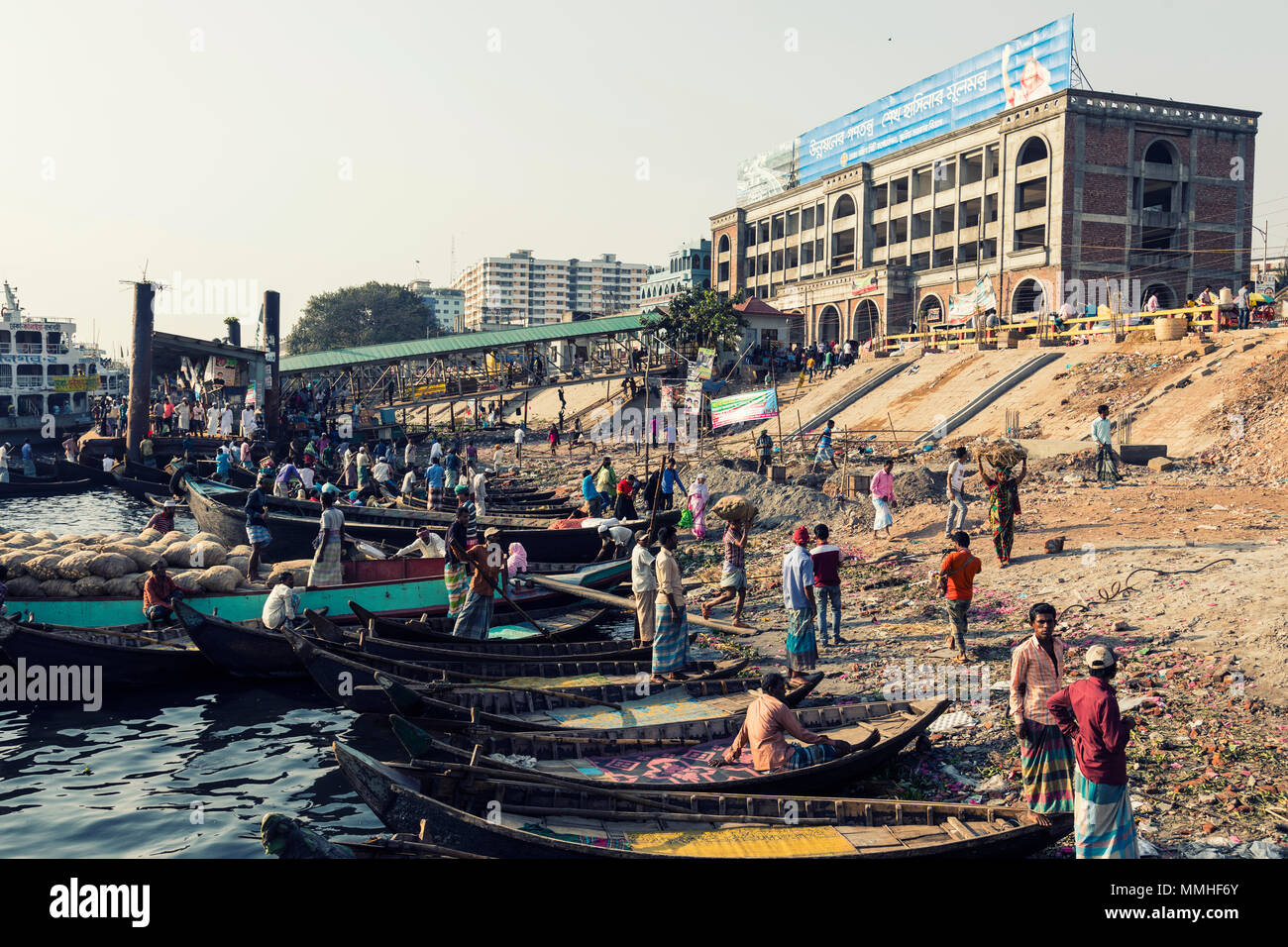 Dhaka, Bangladesh, February 24 2017: Sadarghat terminal with wooden boats and ferries in the background at the Buriganga River in Dhaka Bangladesh (Vi - Stock Image