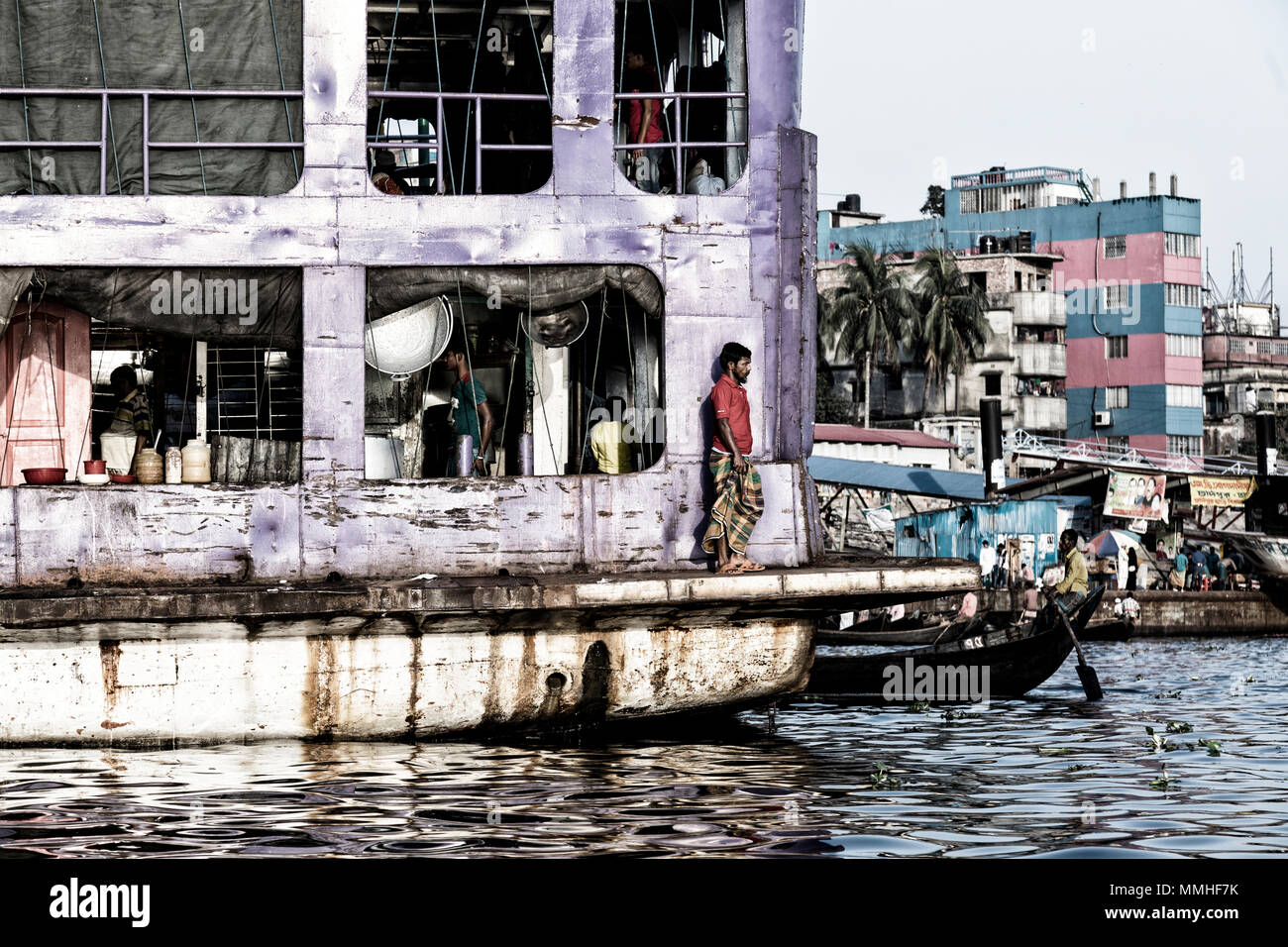 Dhaka, Bangladesh, February 24 2017: Man stands at the stern of an old ship and looks out over the Buriganga River, Sadarghat Terminal in Dhaka, Bangl - Stock Image
