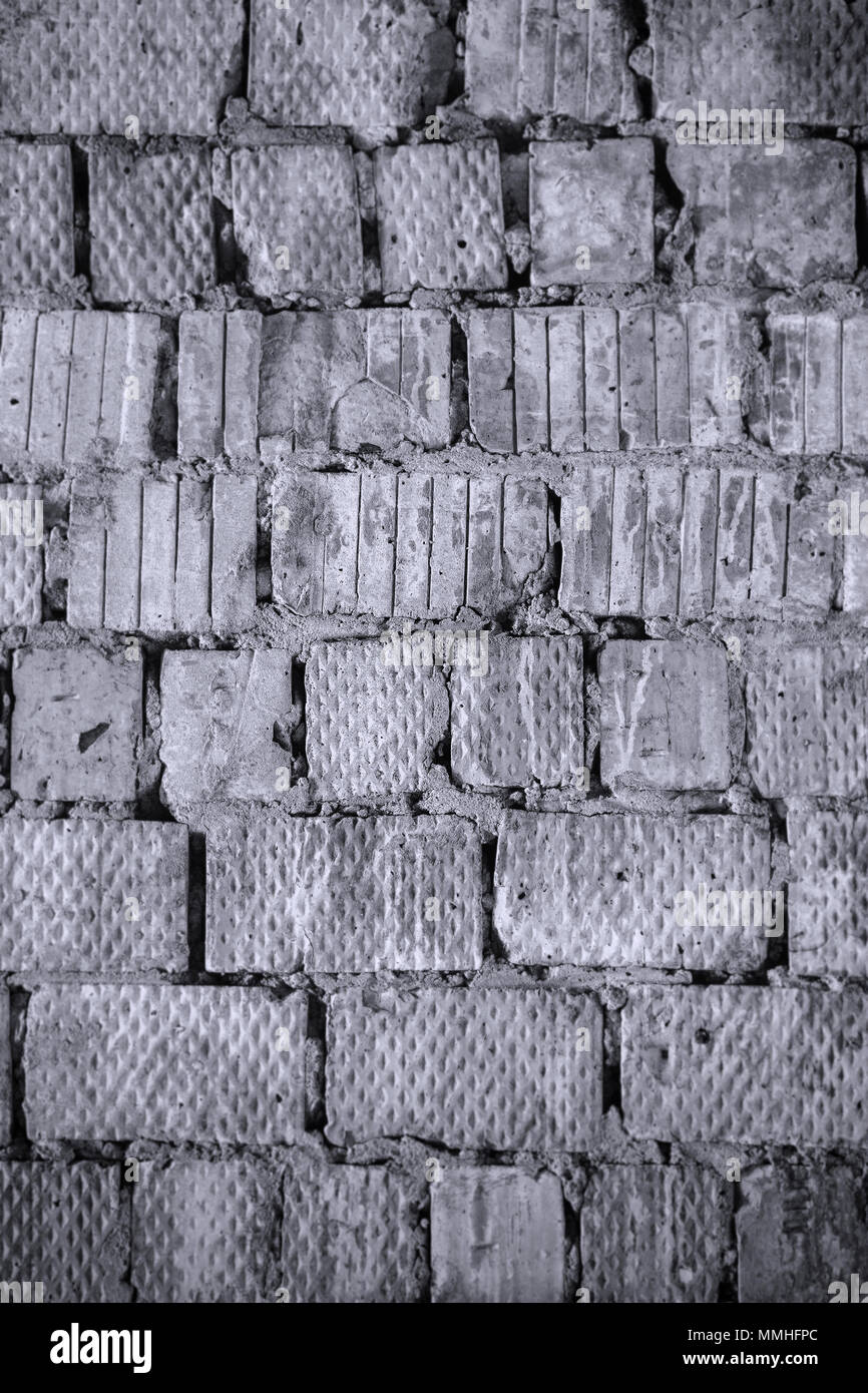The old wall of a square red brick. Background and texture. Black and white photo - Stock Image
