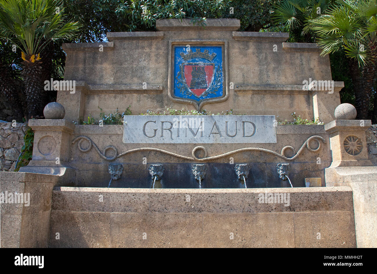 Well with village crest at Grimaud-village, Cote d'Azur, South France, France, Europe - Stock Image