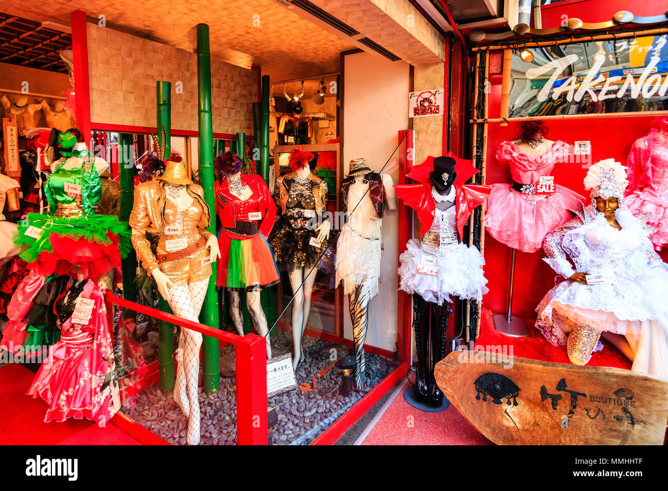 Tokyo, Harajuku, Takeshita street. Famous fashion store, Boutique Takenoko. Mannequins leading to entrance, dressed in various garish gaudy outfits. - Stock Image