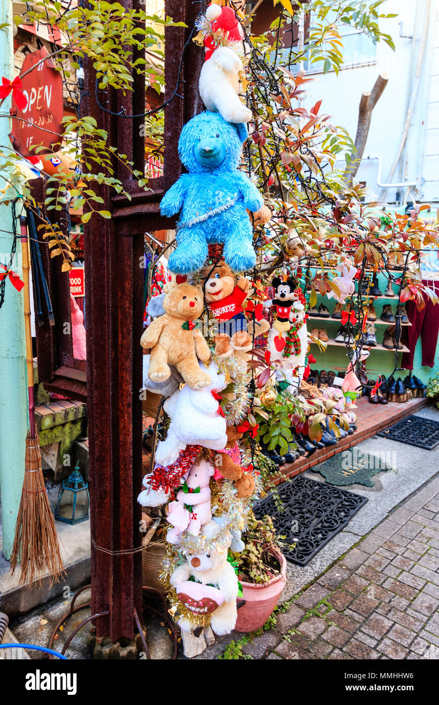 tokyo harajuku takeshita street pole of stuffed teddy bears outside panama boy second hand store christmas decorations wrapped around the pole - Christmas Pole Decorations