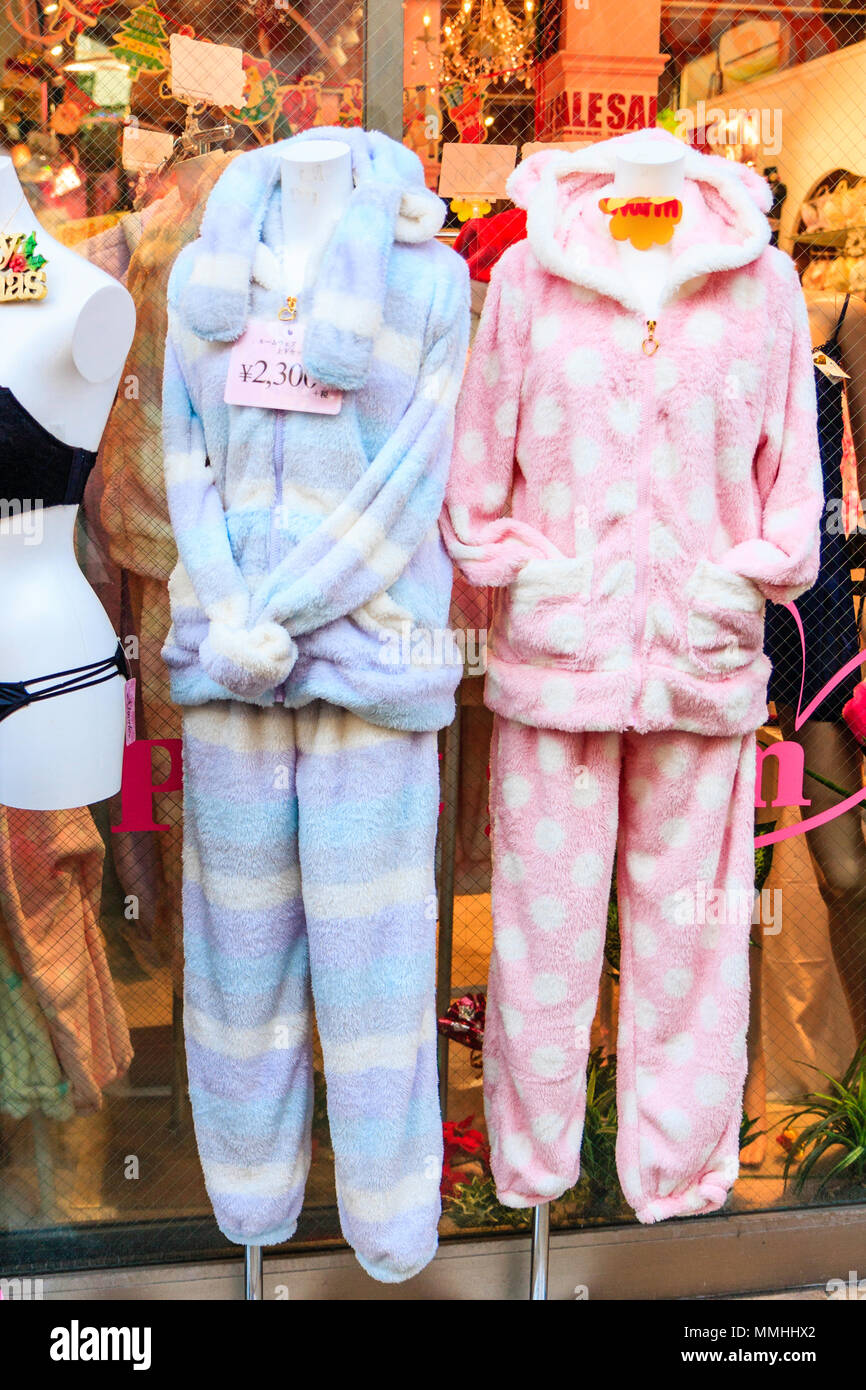 Tokyo, Harajuku, Takeshita street. Women's bed-wear, two-piece thick lounge outfits with hood outside store. Stock Photo