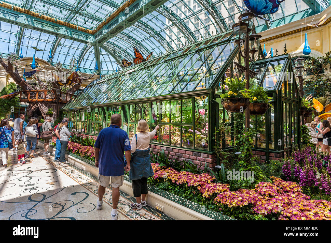 Tourists visiting Bellagio's Conservatory & Botanical Gardens in the Billagio Luxury Resort and Casino on the Las Vegas Strip in Paradise, Nevada Stock Photo