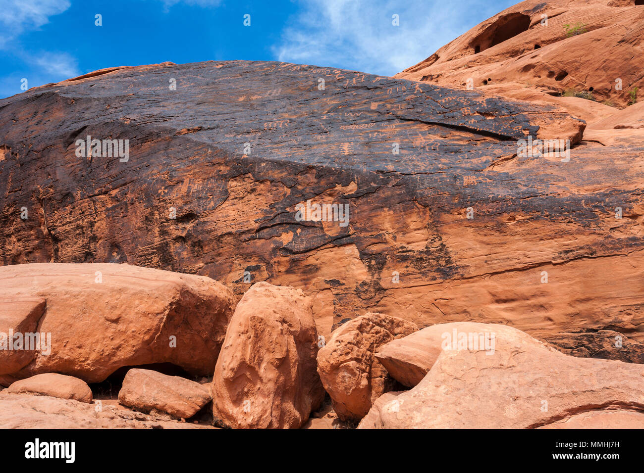 Symbols Etched In Red Aztec Sandstone Rock Formations In The Valley