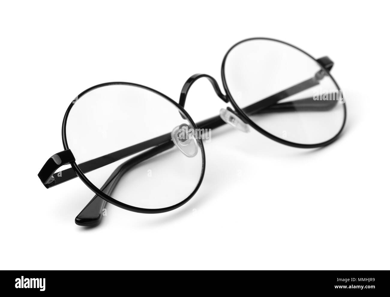 Black classic round eyeglasses isolated on white - Stock Image