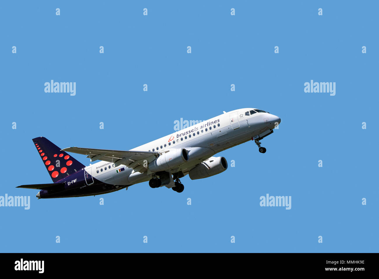 Sukhoi Superjet 100-95B, fly-by-wire twin-engine regional jet from Belgian Brussels Airlines in flight against blue sky - Stock Image