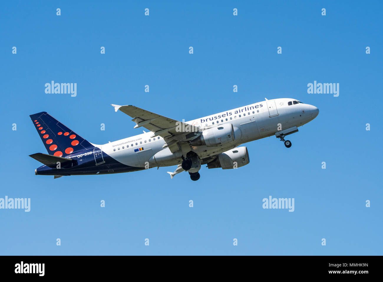 Airbus A319-111, narrow-body, commercial passenger twin-engine jet airliner from Belgian Brussels Airlines in flight against blue sky - Stock Image
