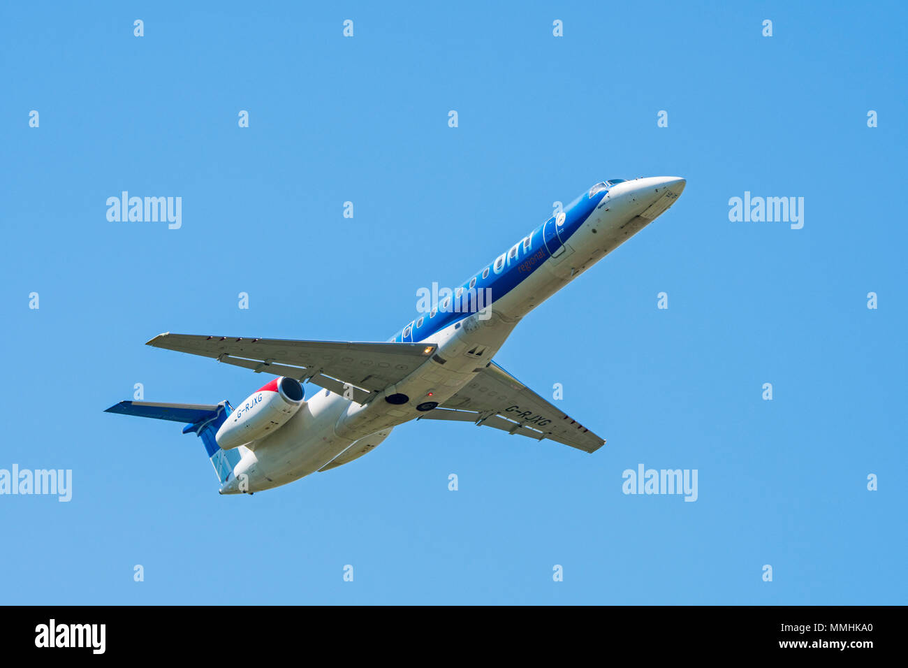 Embraer ERJ-145-EP, twin-engine regional jet from British Midland Regional Limited / Flybmi, British regional airline in flight against blue sky - Stock Image