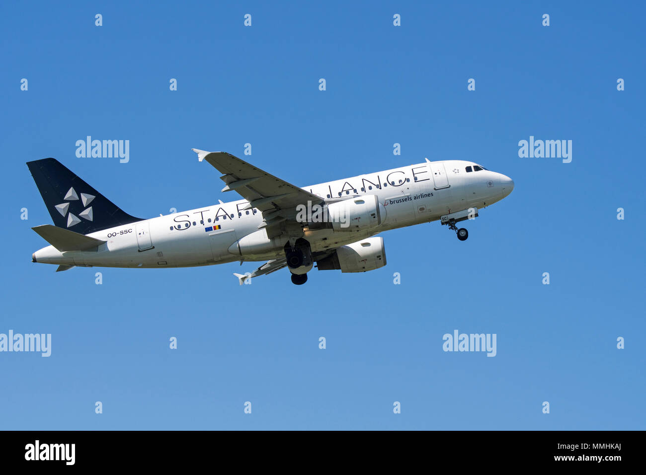 Airbus A319-112, narrow-body, commercial passenger twin-engine jet airliner from Belgian Brussels Airlines in flight against blue sky - Stock Image