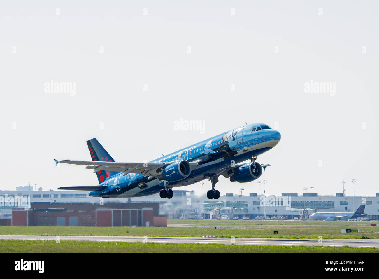 Airbus A320-214 in Magritte livery, commercial passenger twin-engine jet airliner from Belgian Brussels Airlines taking off from Brussels Airport - Stock Image