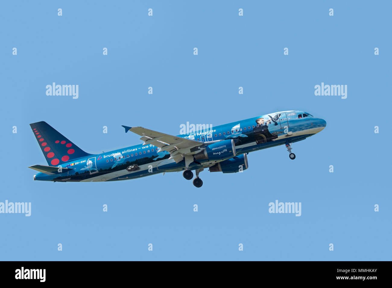 Airbus A320-214 in Magritte livery, narrow-body, commercial passenger twin-engine jet airliner from Belgian Brussels Airlines in flight - Stock Image
