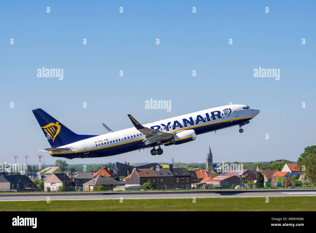 Boeing 737-8AS, short- to medium-range twinjet narrow-body airliner from Ryanair DAC, Irish low-cost airline taking off from runway - Stock Image