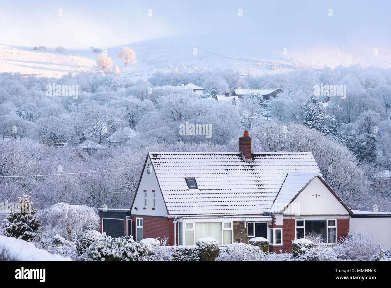 House covered by snow presenting winter dreamland in the british countryside. Stock Photo