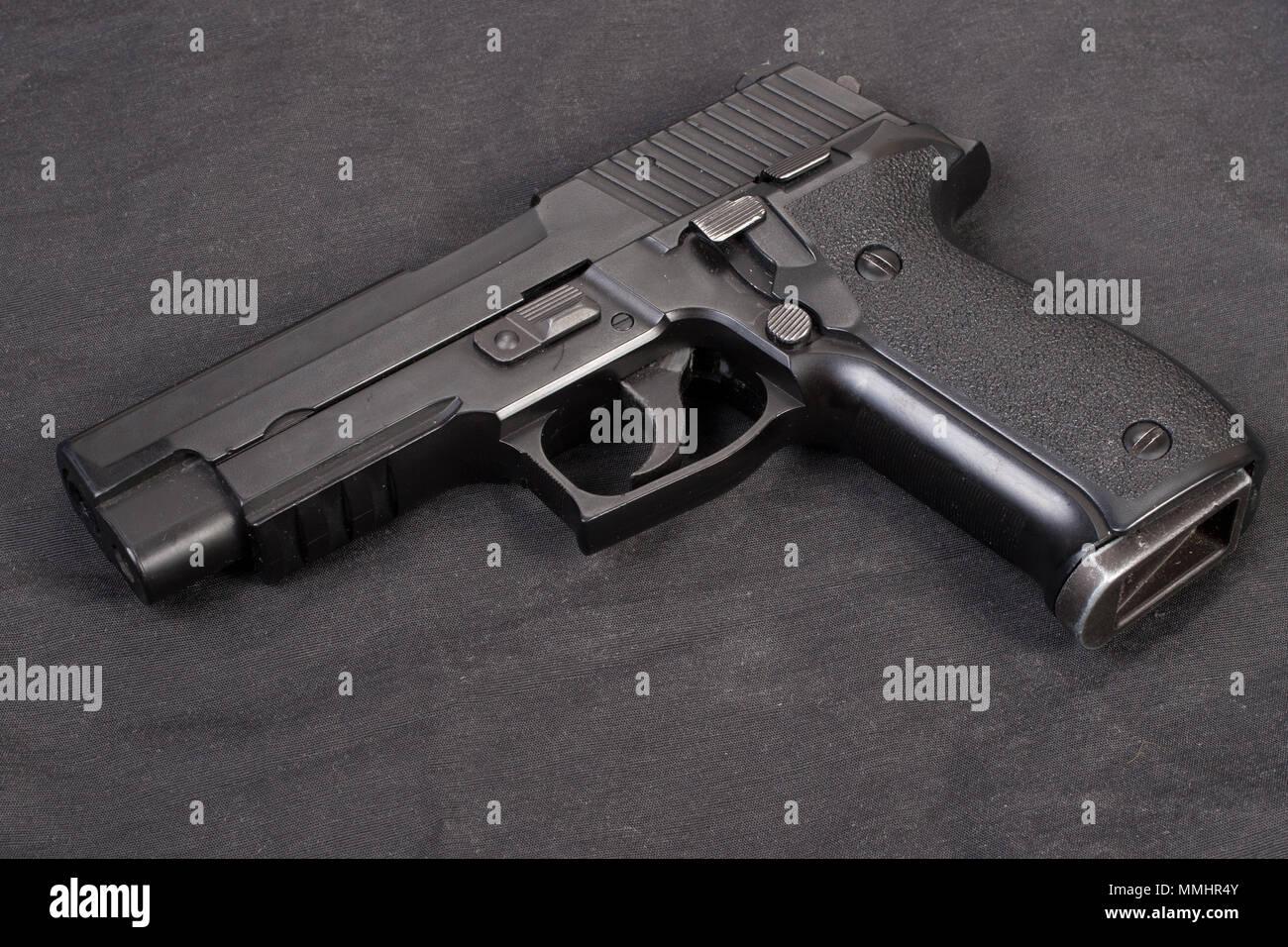 sig sauer hand gun on black - Stock Image