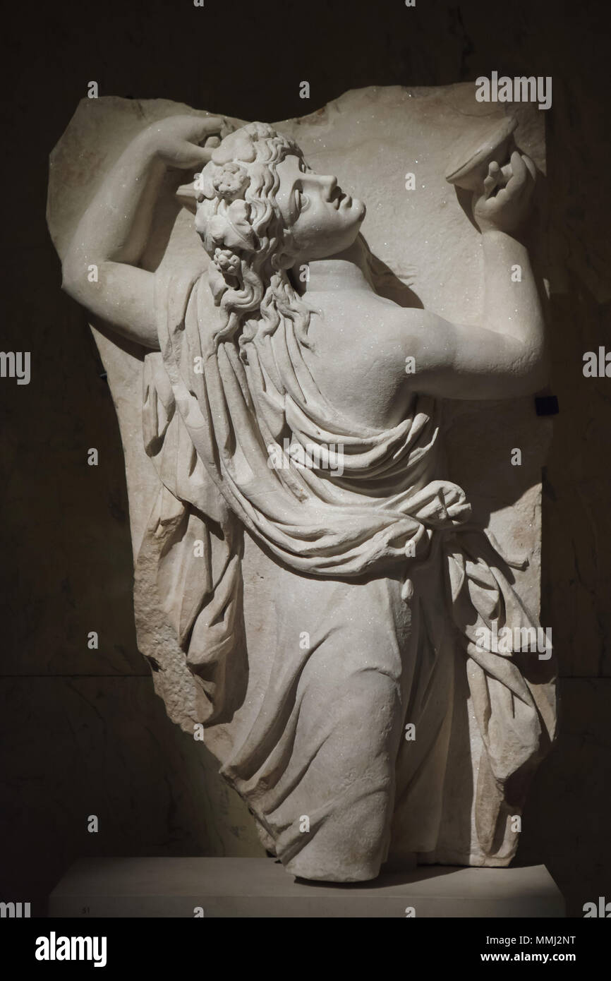 Dancing Maenad. Roman marble relief from the 2nd half of the 2nd century AD on display in the Kunsthistorisches Museum, Vienna, Austria. Stock Photo