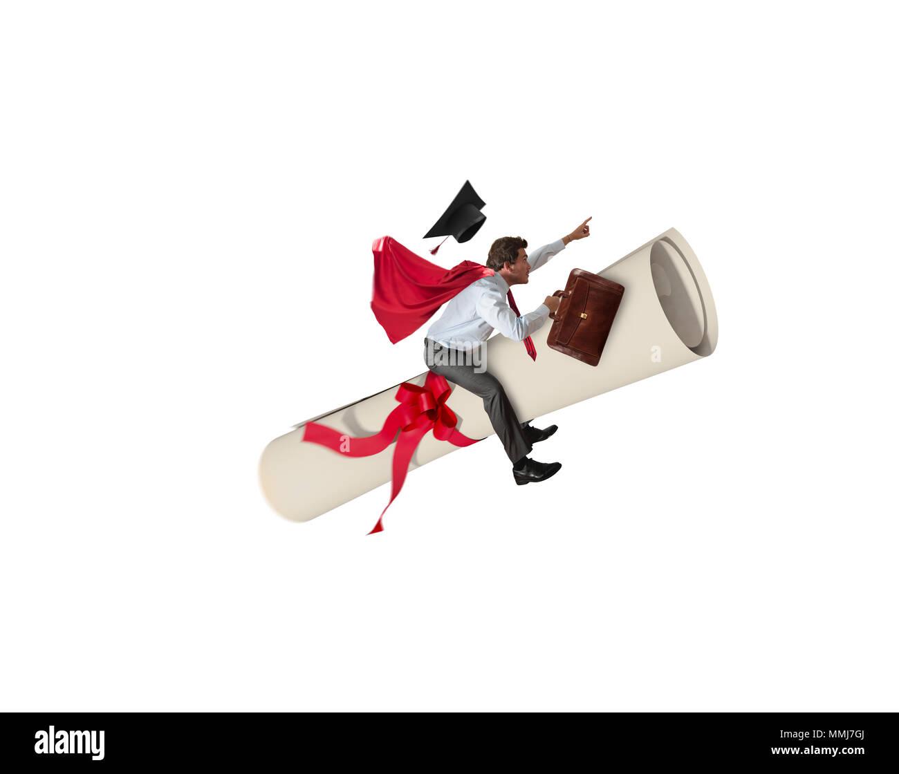 Young graduate boy rides a graduation parchment - Stock Image