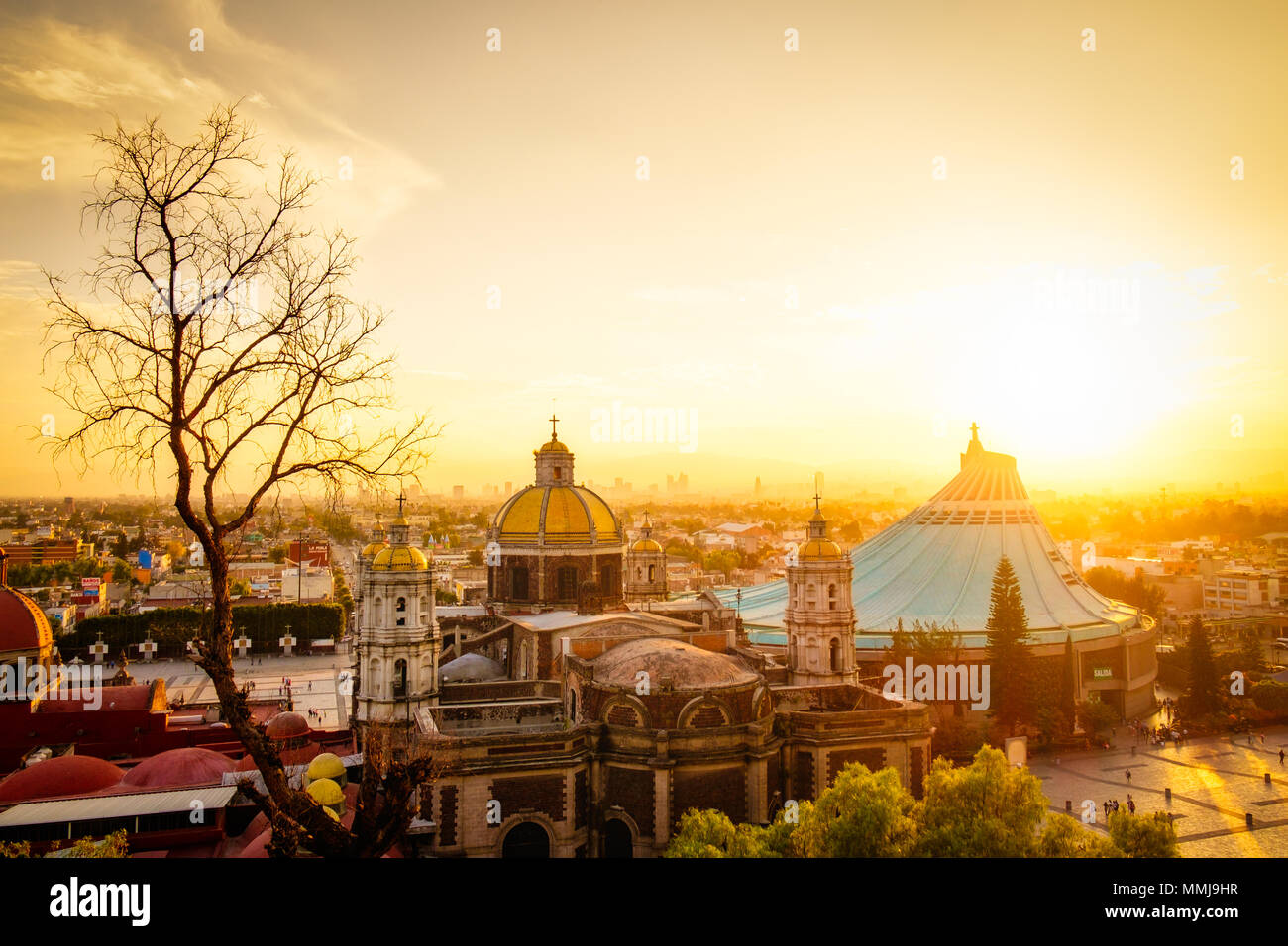 Scenic view at Basilica of Guadalupe with Mexico city skyline at sunset, Mexico - Stock Image