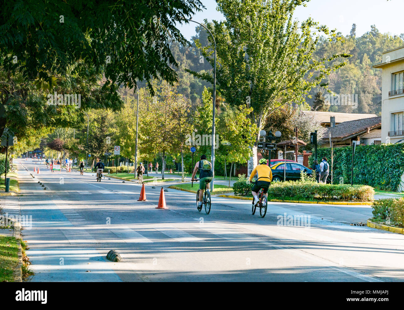 Pedro de Valdivia Street, quiet on Easter Sunday and closed to cars for public recreation with cyclists in street - Stock Image