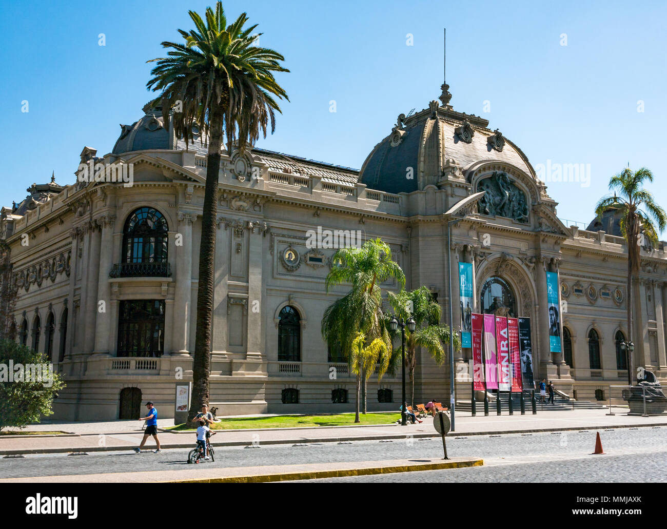 National Museum of Fine Arts, Santiago, Chile, South America, on quiet Easter Sunday with no traffic and people walking along pavement - Stock Image