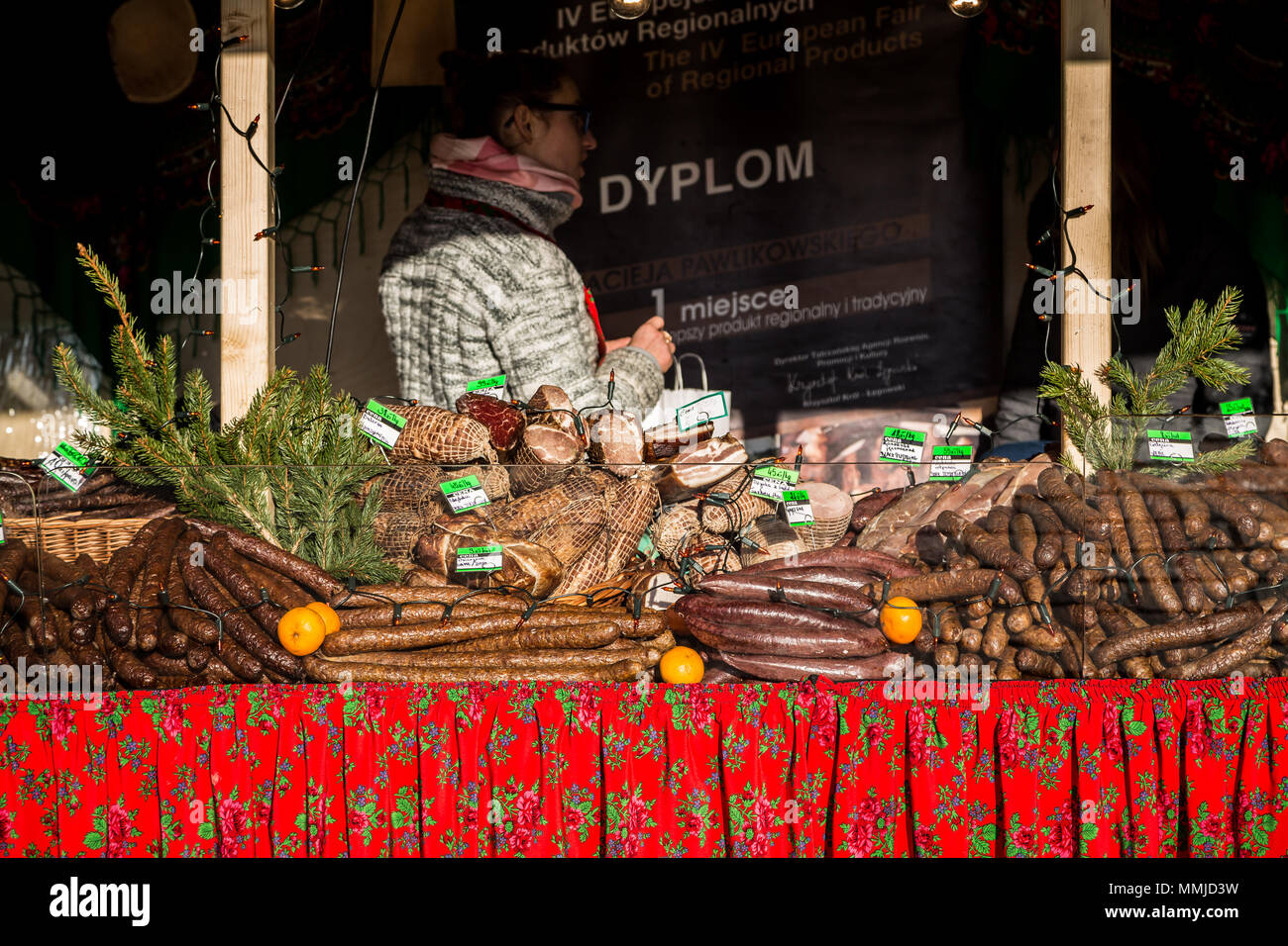 Traditional meat products on Christmas market stand in Krakow, Poland - Stock Image
