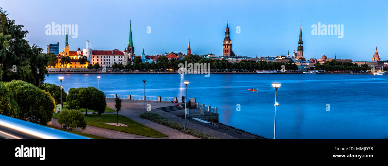 Traditional Riga skyline during blue hour. - Stock Image