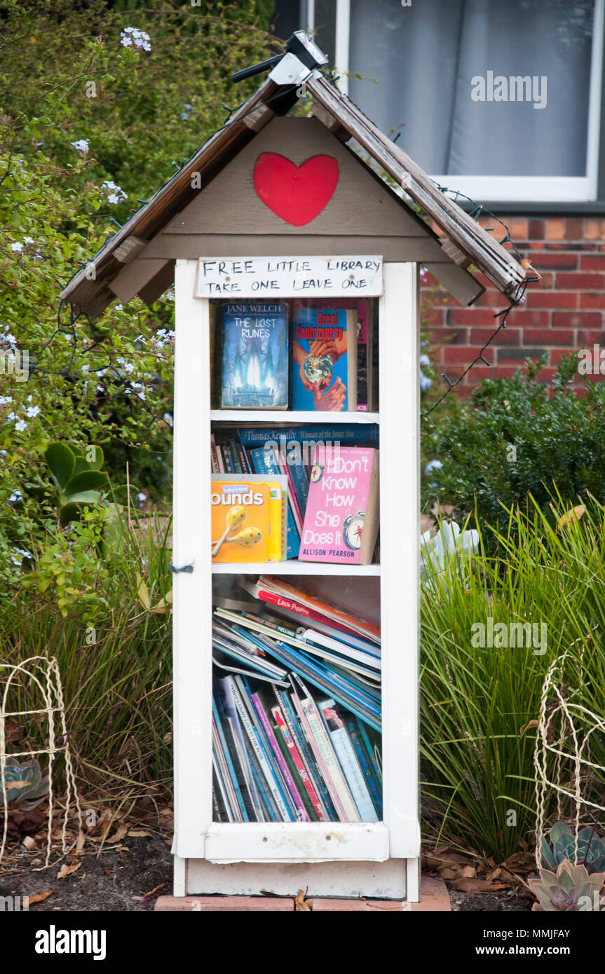 Community free library initiative outside a suburban home in Melbourne, Australia - Stock Image