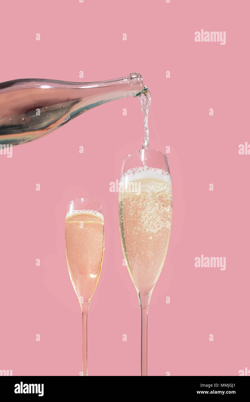 Valdobbiadene Prosecco flutes and a bottle, pink background, in pop contemporary style - Stock Image