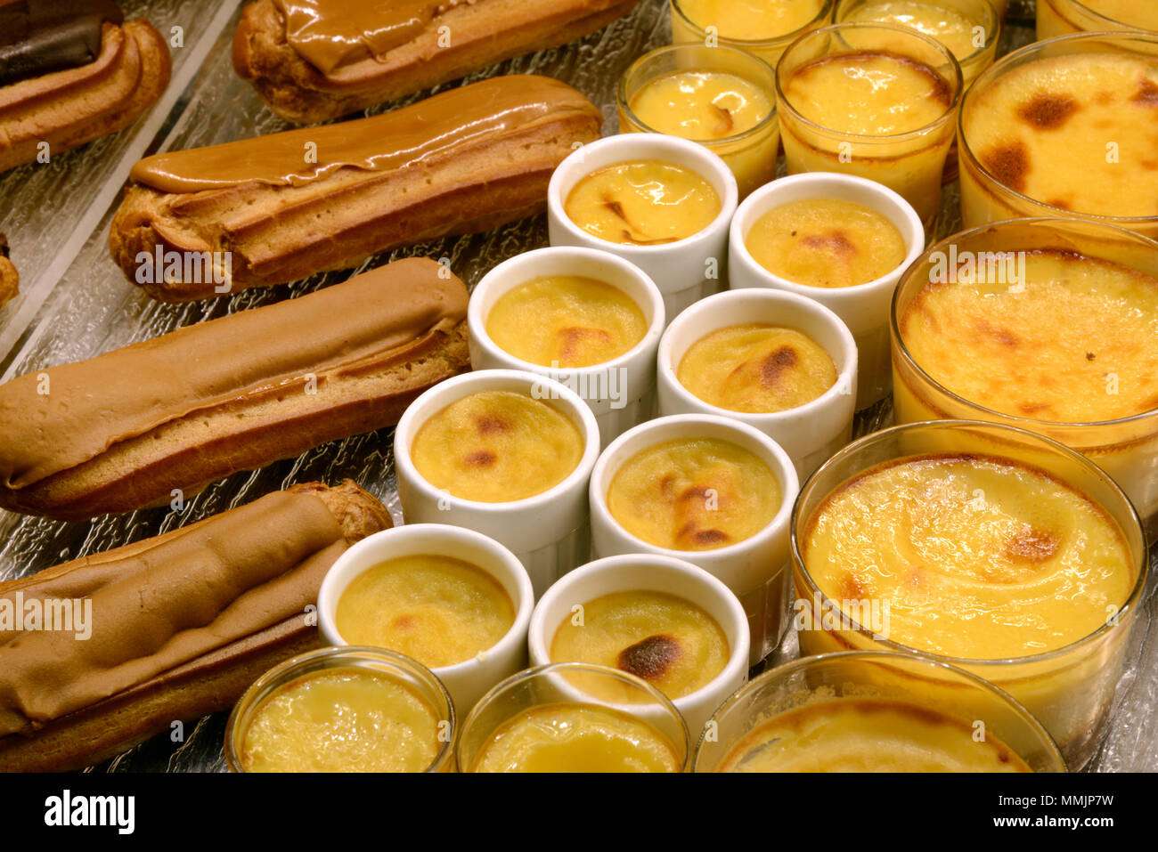 Display of Crèmes Caramels & Coffee Eclairs Pastries or Cakes in a French Patisserie France - Stock Image