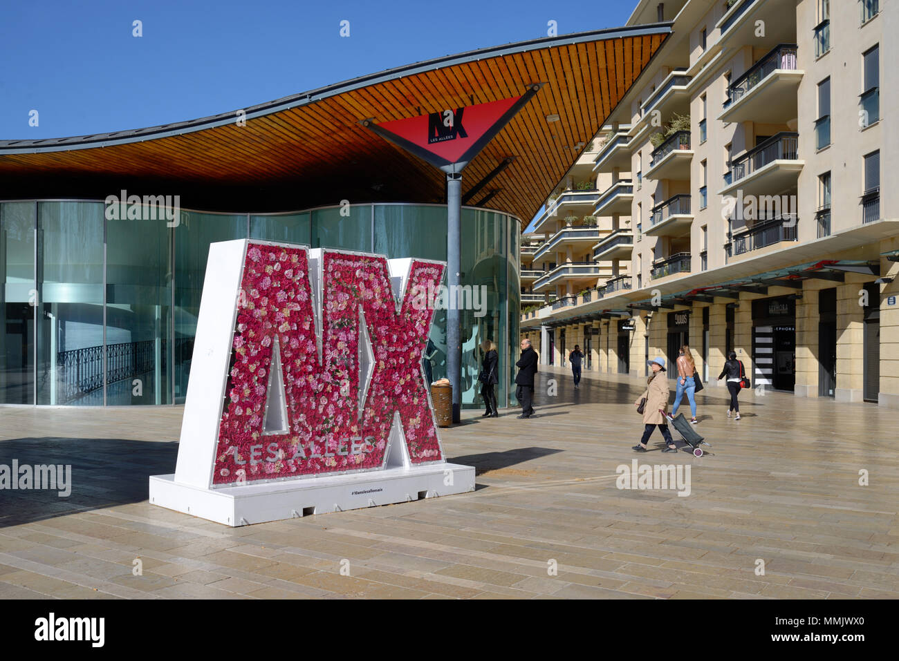 Sign for 'Aix' Made of Paper or Plastic Roses in Shopping Centre or Shopping Mall Les Allées Provençales Aix-en-Provence Provence France - Stock Image