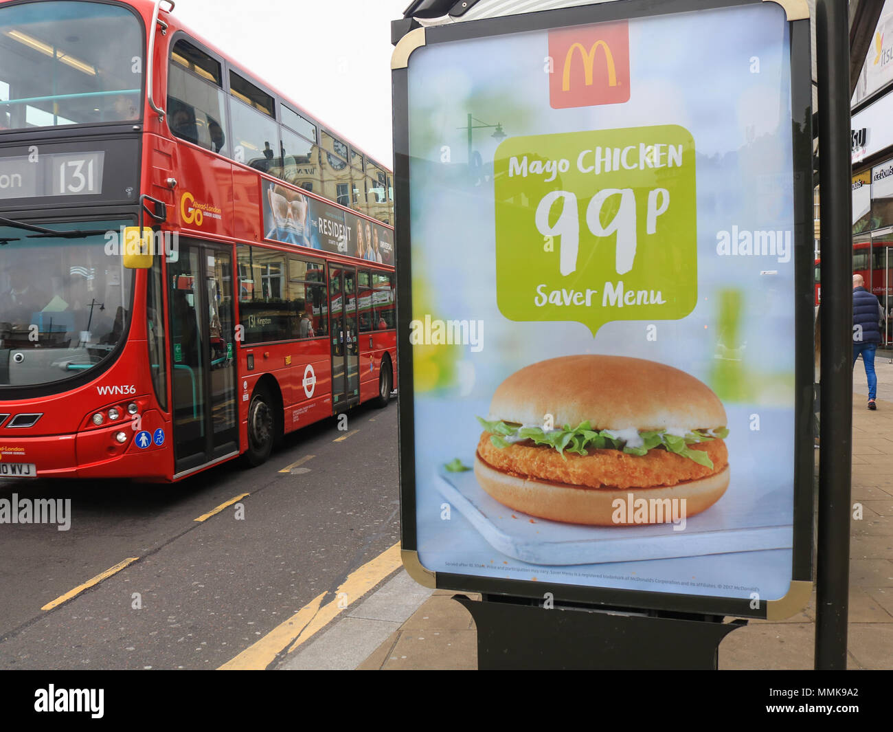 London UK. 12th May 2018. A bus stop in Wimbledon advertising cheap meals by fast food giant McDonlads. London Mayor Sadiq Khan has announced plans to ban junk food ads on London TFL iin order to reduce the growing epidemic of childhood obesity Credit: amer ghazzal/Alamy Live News - Stock Image