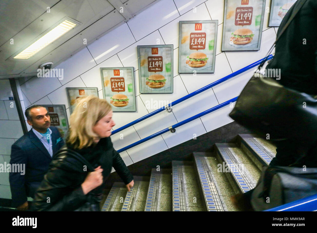 London UK. 12th May 2018. An underground station in Oxford Circus advertising cheap meals by fast food giant McDonlads. London Mayor Sadiq Khan has announced plans to ban junk food ads on London TFL iin order to reduce the growing epidemic of childhood obesity Credit: amer ghazzal/Alamy Live News - Stock Image