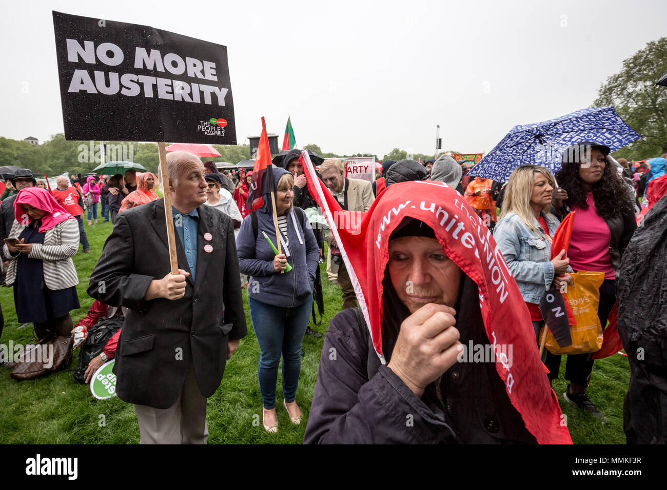 London, UK. 12th May, 2018. Despite the heavy rain, thousands turn up to hear the Labour Party leader, Jeremy Corbyn, address trade unionists during a TUC rally in Hyde Park on the theme of 'a new deal for working people', aimed against government austerity and injustice. Credit: Guy Corbishley/Alamy Live News - Stock Image