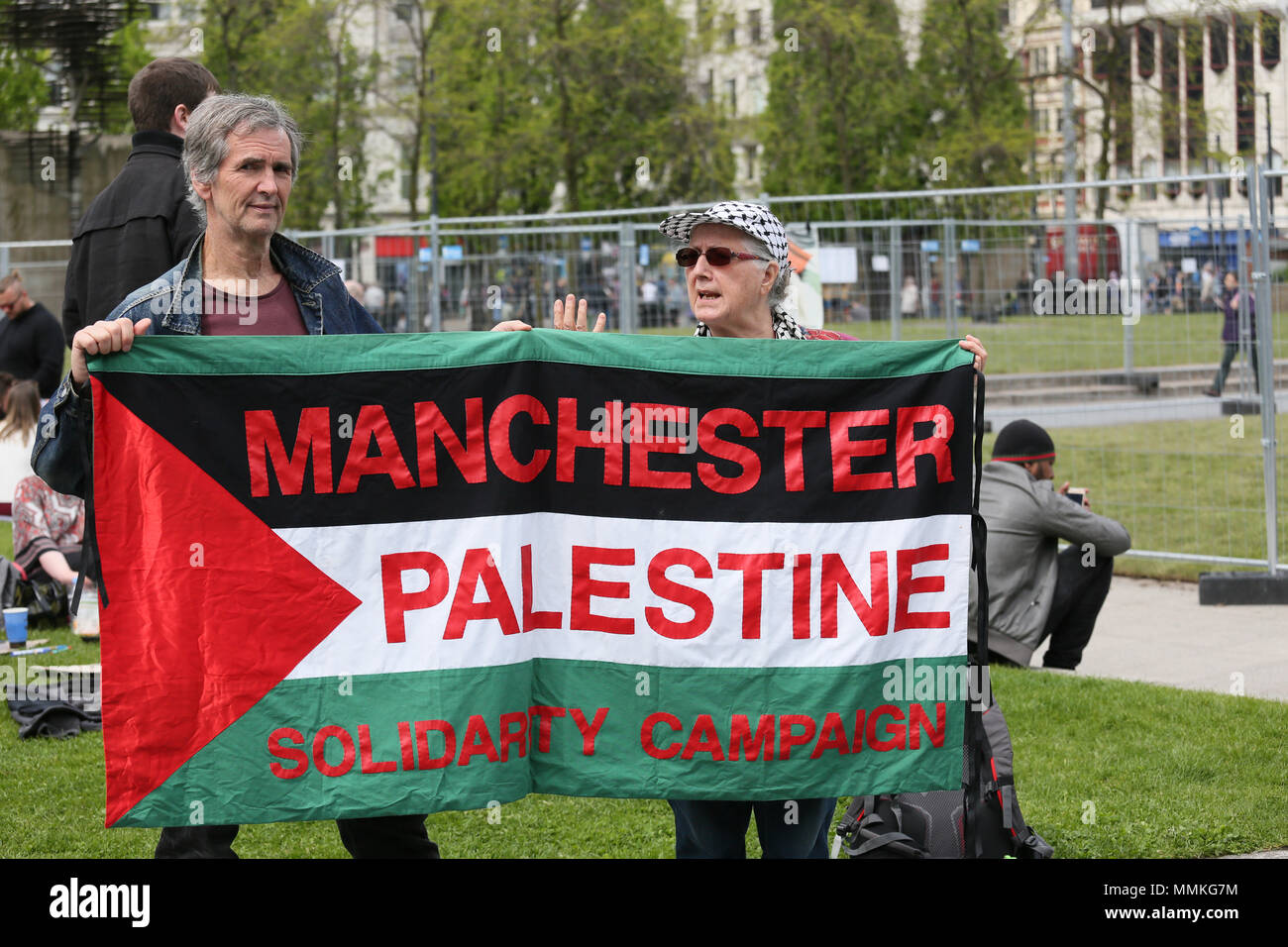 Manchester, UK. 12th May 2018. A Palestine Solidarity Campaign banner held up at a pro Palestinian camp for Nakba Day which commemorates the displacement of Palestinians  in 1948, when the Israeli state was founded.  Nakba, is an Arabic word meaning 'disaster'.  Piccadilly Gardens, Manchester,12th May, 2018 (C)Barbara Cook/Alamy Live News - Stock Image