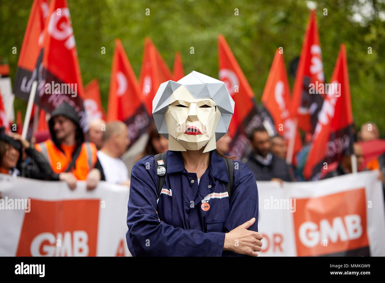 London, UK. 12th May 2018. A protestor wears a mask of Thersea May ahead of marchers at the TUC rally and march in London. Credit: Kevin Frost/Alamy Live News Credit: Kevin Frost/Alamy Live News - Stock Image