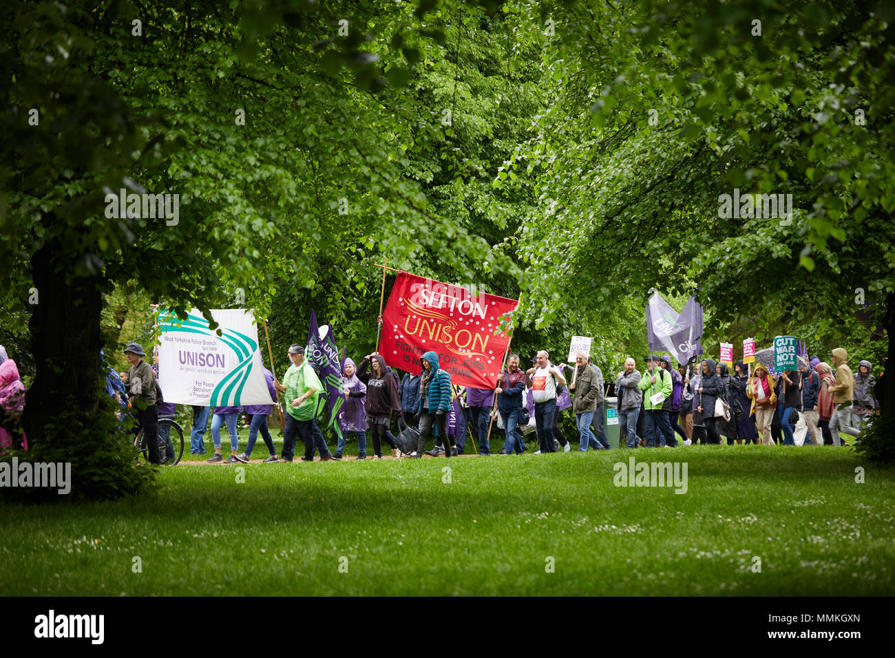 London, UK. 12th May 2018. London, UK. 12th May 2018. London, UK. 12th March 2018. Protestors march through a park in the rain towards a TUC rally. Credit: Kevin Frost/Alamy Live News Credit: Kevin Frost/Alamy Live News Credit: Kevin Frost/Alamy Live News - Stock Image