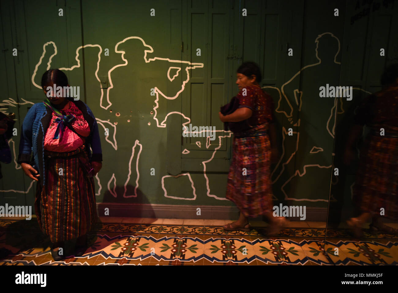 Ciudad De Guatemala, Guatemala. 12th May, 2018. Two indigenous women attend the inauguration event in the Casa de la Memoria, in Guatemala City, Guatemala, on 10 May 2018. In the front yard of the Casa de la Memoria, in the historic center of Guatemala City, some 70 Ixil indigenous people settle in chairs, standing and on the floor to be photographed by personnel from the Center for Legal Action in Human Rights ( CALDH). Credit: EDWIN BERCIÁN/EFE/Alamy Live News - Stock Image