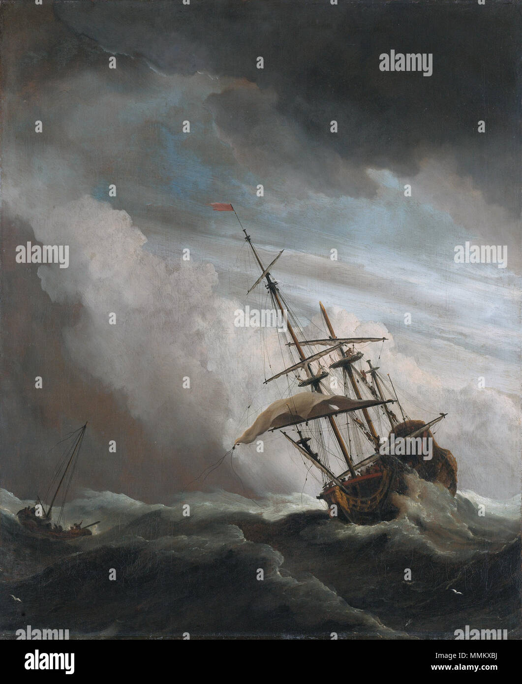 . A ship in high seas in a heavy storm. A three-masted ship on a high wave. To the left a smaller vessel. Pendant of File:Het Kanonschot - Canon fired (Willem van de Velde II, 1707).jpg.  The Gust of Wind  *oil on canvas  *77 x 63.5 cm  *signed b.l.: W. v. Velde f.  *ca. 1650 - ca. 1707 De Windstoot - A ship in need in a raging storm (Willem van de Velde II, 1707) Stock Photo
