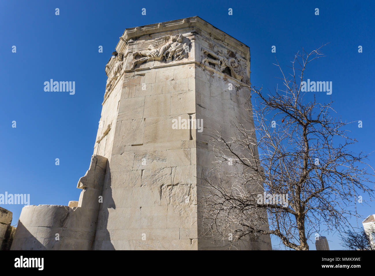 """Tower of winds in the roman market, Athens Greece. A clock tower functioned as a """"timepiece"""".It is considered the world's first meteorological station Stock Photo"""